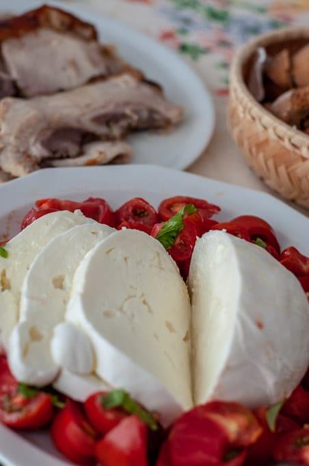 Zizzona mozzarella on a large plate with tomato