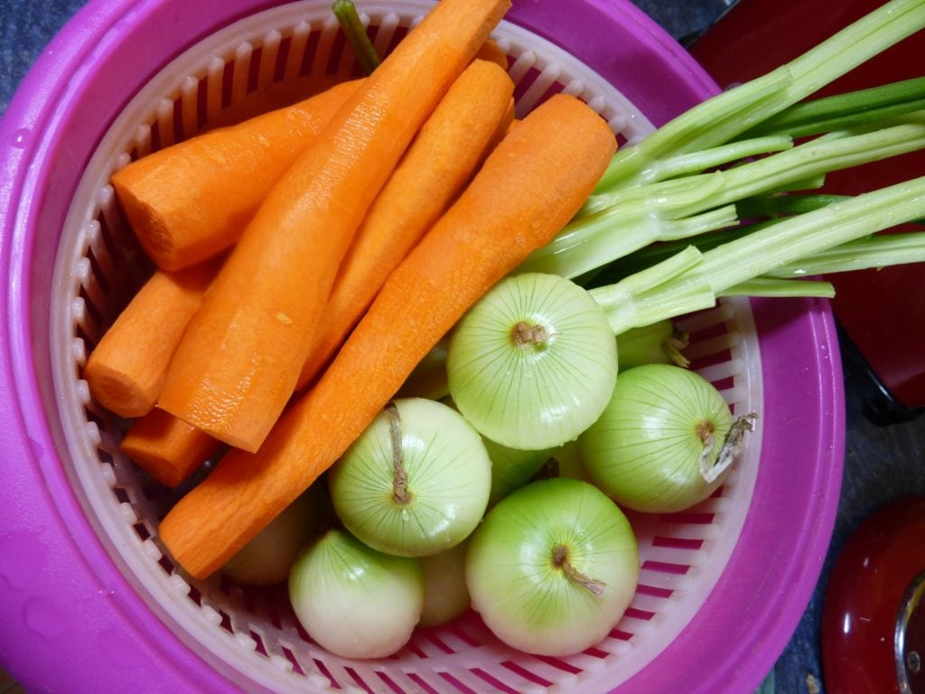 onions, carrots and celery in a bucket
