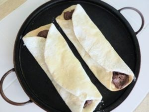 Pizza with nutella lay on pizza stone