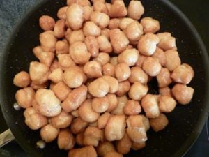Struffoli in a pan with honey