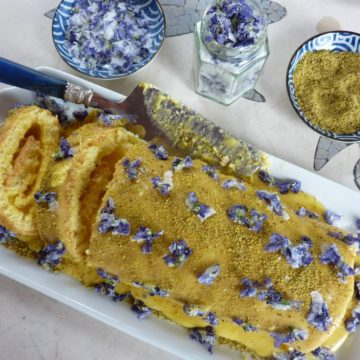 swiss roll sponge homemade crystallised violets butter cream and pistachios