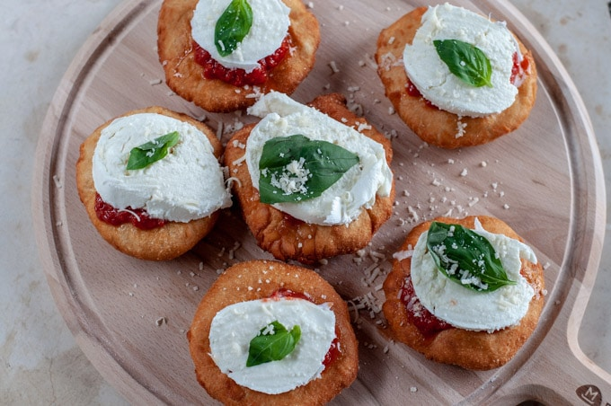 Fried pizza with tomato sauce, fresh mozzarella and basil