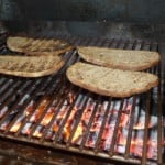 Bruschetta rustic bread cut in slices and toasted over the charcoal.