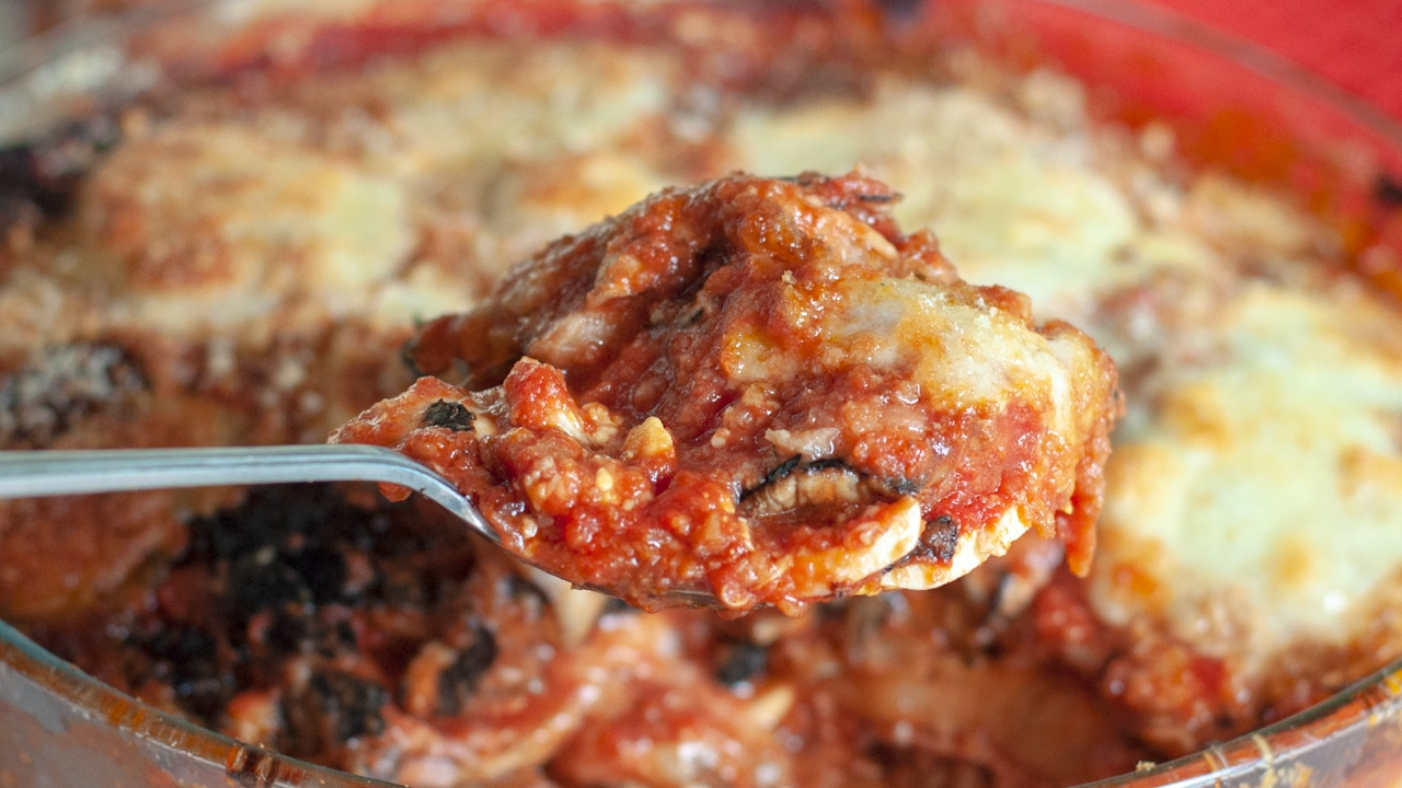Eggplant parmesan on a spoon