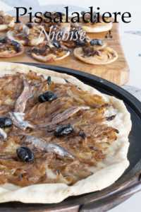 Pissaladiere Nicoise is dish sold in many bakeries as a starter or snack. It is a pizza base topped by Mediterranean onions, anchovies and olives. #yourguardianchef #frenchfood #pizza