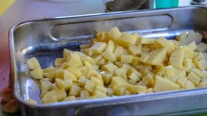 Pour the potatoes in a baking tray