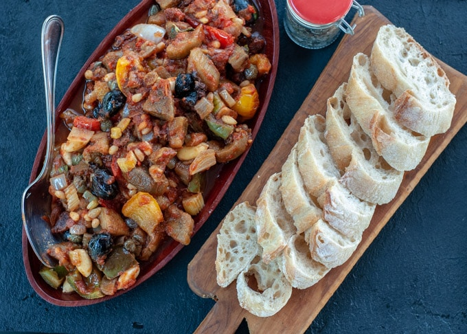 Caponata on a serving dish and slices of baguette-1