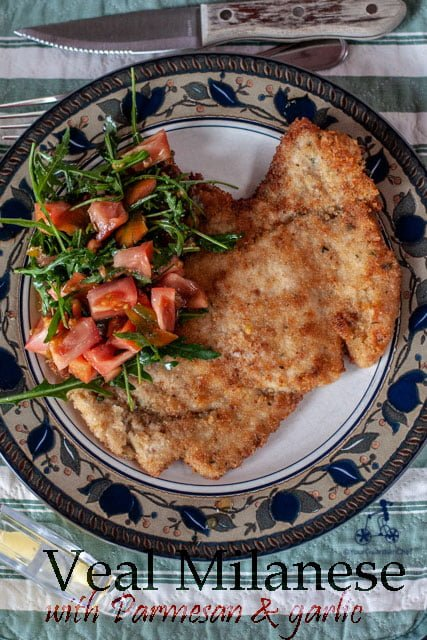 Veal Milanese is a fried breaded veal cutlet, a typical recipe from Milan usually served with an arugula salad and/or french fries. Some restaurants in Milan serve a huge cutlet also called Elephant Ear, larger than the plate in which it is served. #yourguardianchef #Italianrecipe #italianfood #veal