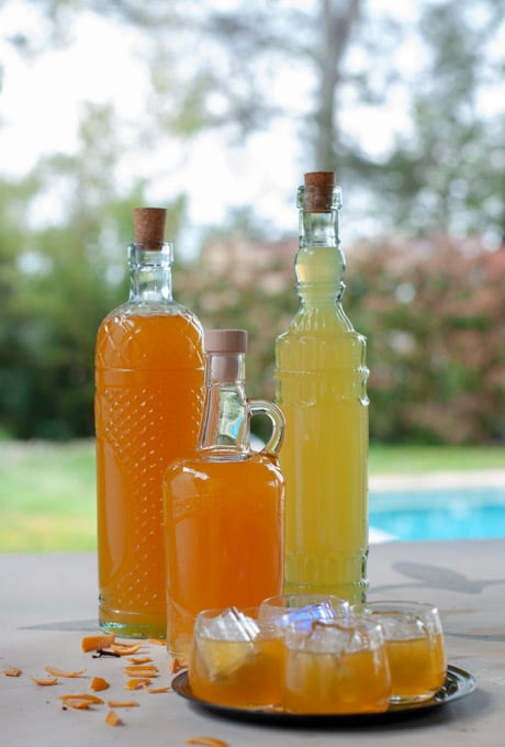 Homemade orange liquor in fancy bottles and served in small glasses