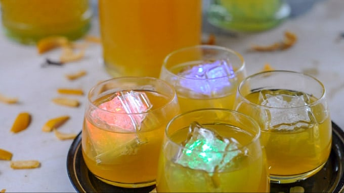 Orange liquor served in small glasses with colored ice