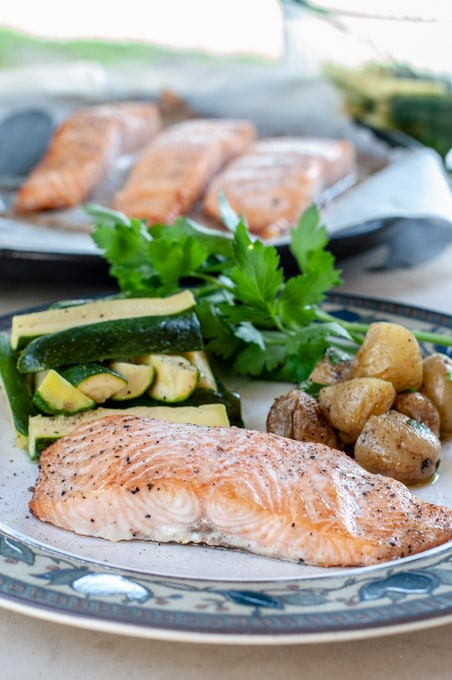 Baked Salmon Fillet In Oven With steamed zucchini and potato salad