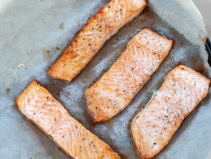 baked salmon fillet in oven on parchment paper