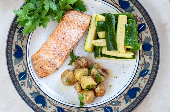 vertical view of salmon zucchini and potatoes on a plate