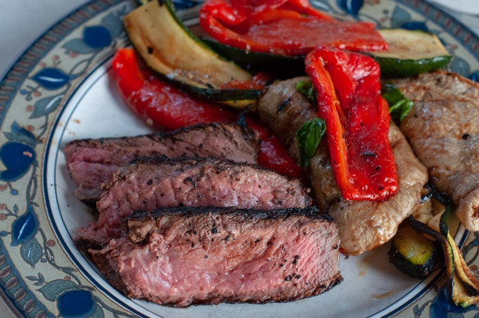 Grilled Zucchini Eggplants And Peppers Salad on a plate with Fiorentina steak