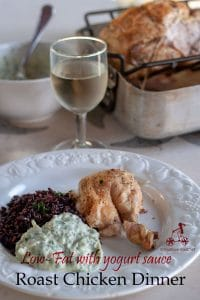 A healthy roast chicken dinner with no added fat to roast the chicken and still keeping it juicy. Served with black rice and yoghurt sauce.