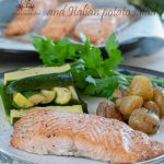 Baked Salmon fillet in oven served with steamed zucchini and Italian potato salad, it is easy and quick to make, a dinner for a busy day. Low calories, healthy and delicious!