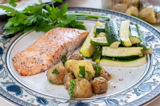 Italian potato salad served with salmon and zucchini