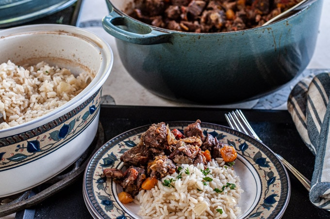 Daube provencal served on a plate with baked rice