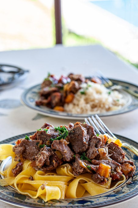 Beef daube provencal served with tagliatelle and in the background with rice