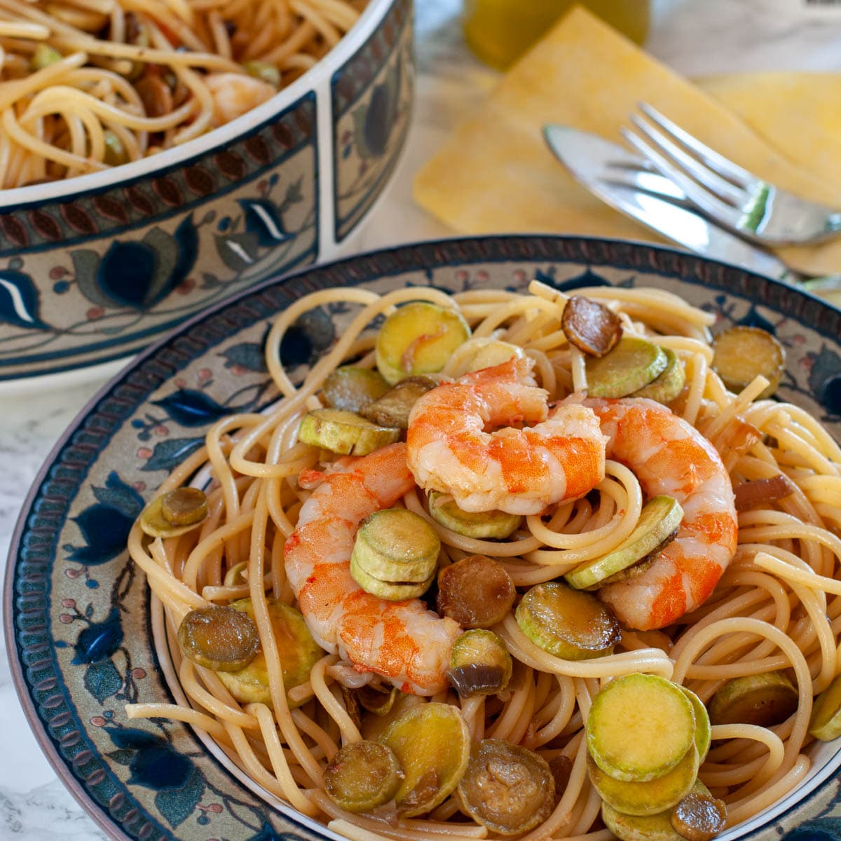 Pasta zucchini with shrimp served on a plate