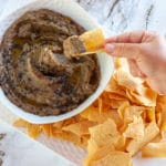 socca chip dipping into aubergine caviar