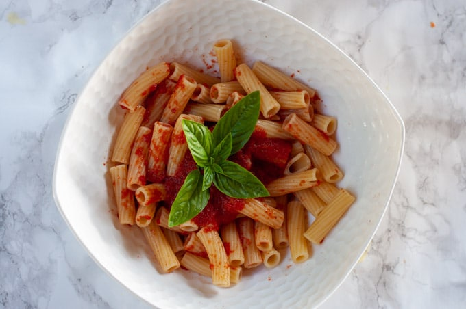 Simple pasta with tomato sauce and basil