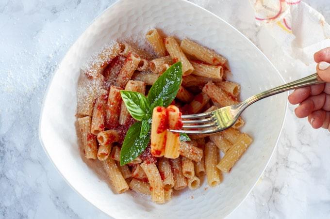 Eating Maccheroni with simple tomato sauce