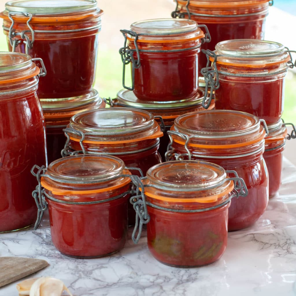 Tomato sauce with fresh tomatoes in jars