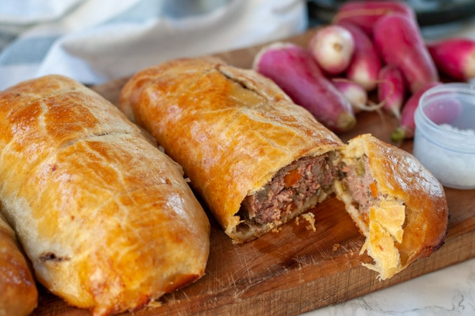 Beef sausage hand pies on a cutting board