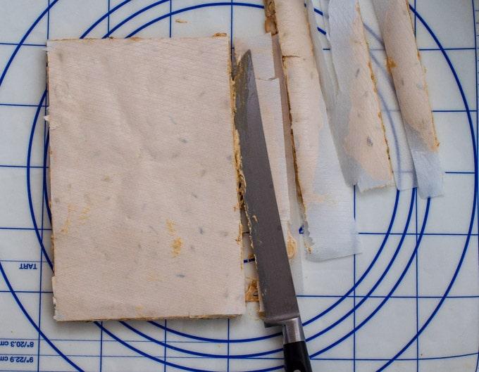 Cut the nougat in stripes