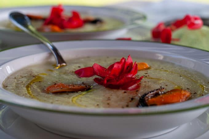 Chayote squash recipe with mussels and Begonia on a plate with a spoon
