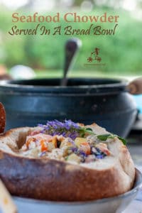 This seafood chowder recipe is a reproduction of the chowder I discovered on my first trip to Ireland, creamy and packed with large chunks of seafood. Mussels, cod and salmon chowder to eat in a bread bowl or with a nice slice of Irish brown bread.