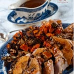 This stuffed pork tenderloin has nice contrasting flavours with the fruity cranberries and lemon zest, and the nuttiness of the chestnuts mixed with a glass of cognac give a nice finishing touch to the flavours.
