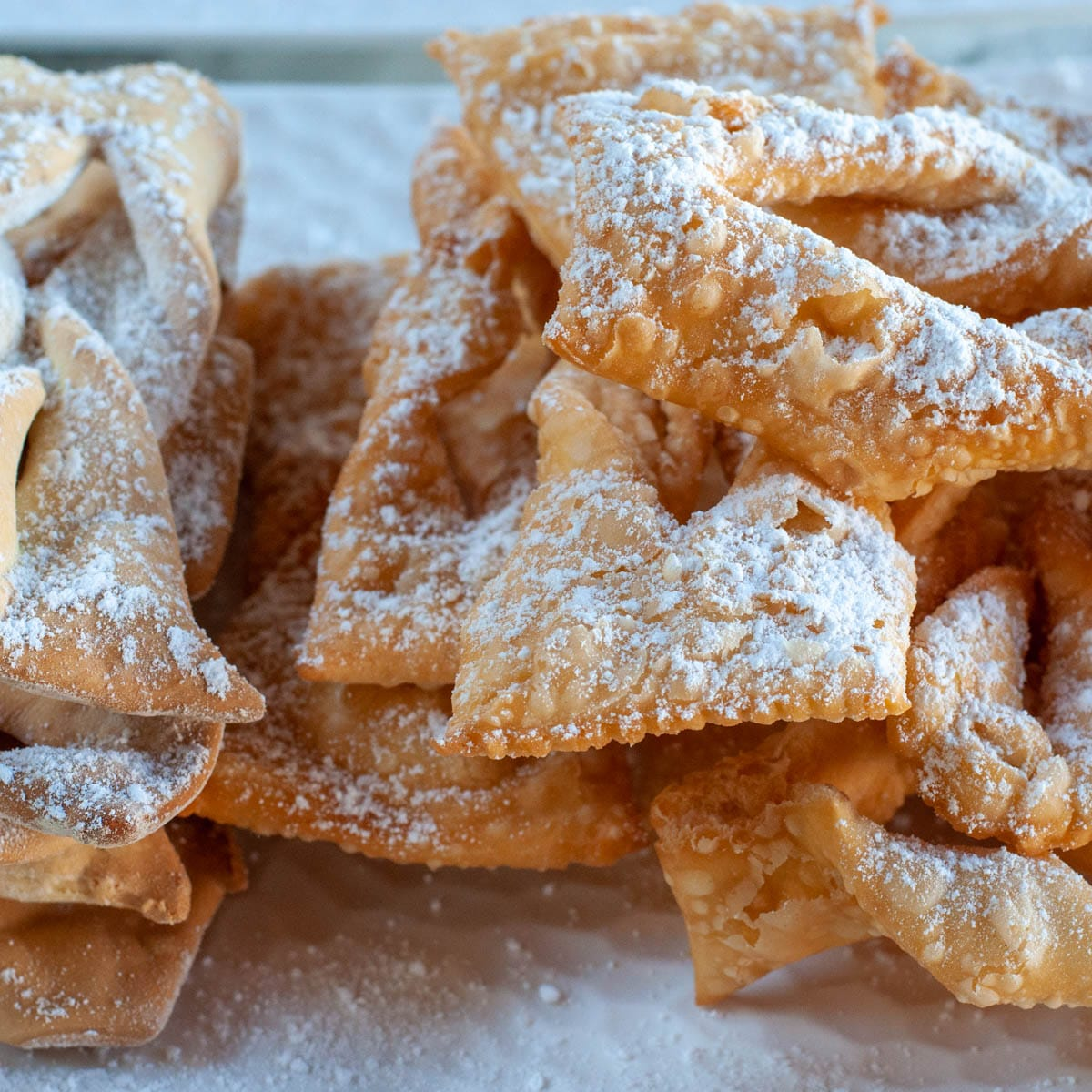 Orelliette Chiacchiere on a serving dish dusted with icing sugar