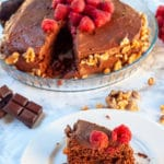 Creamy and nutty chocolate sponge cake: dark chocolate taste with a soft foamy texture created by the whipped egg whites. The perfect base for a cake covered with chocolate icing and topped with fruity raspberries to complete.