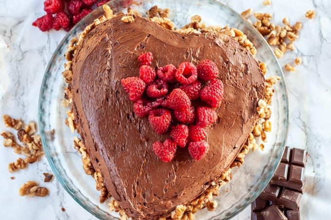 heart-shaped chocolate sponge cake with raspberries