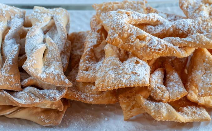 Chiacchiere covered with icing sugar