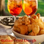 These savoury Italian fried dough balls called Crispelle is a classic appetizer we offer with the aperitif especially at Christmas and New year. Inside the fried dough there is a small piece of anchovy, crunchy outside and soft inside ending with the salty bite of the anchovy or sundried tomato, perfect to serve with a sweet Spritz or Mimosa.