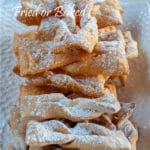 This Oreillettes or Chiacchiere recipe is a traditional dessert usually sold during holidays in Italy and in France at Christmas as well as Carnival. They are strips of fried dough covered with icing sugar, crunchy and thin. Once you eat one you cannot stop.
