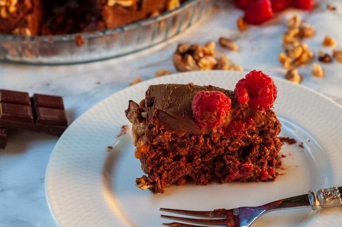 Slice of Walnut Dark Chocolate Sponge Cake on a plate