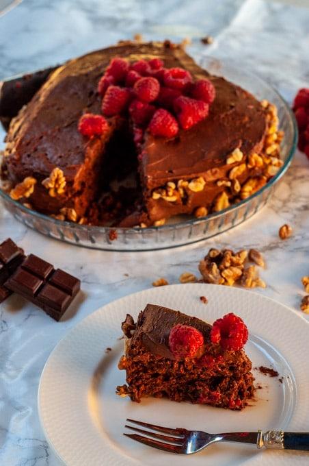 Walnut Dark Chocolate Sponge Cake slice served on a plate