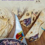 I make these healthy chicken wraps when I have a boring boiled chicken I need to use. I serve it with a healthy salad mix, flavored with some grated Parmesan, and wrapped in these freshly homemade wraps: a bland boiled chicken turned into one of our favorite healthy dinners.