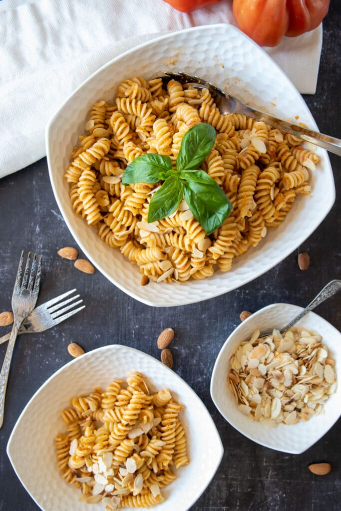 pasta with red pesto served in a bowl