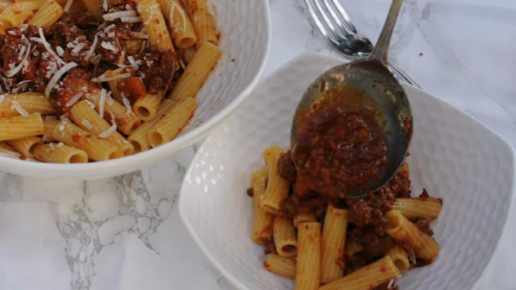 Bolognese sauce poured over the pasta