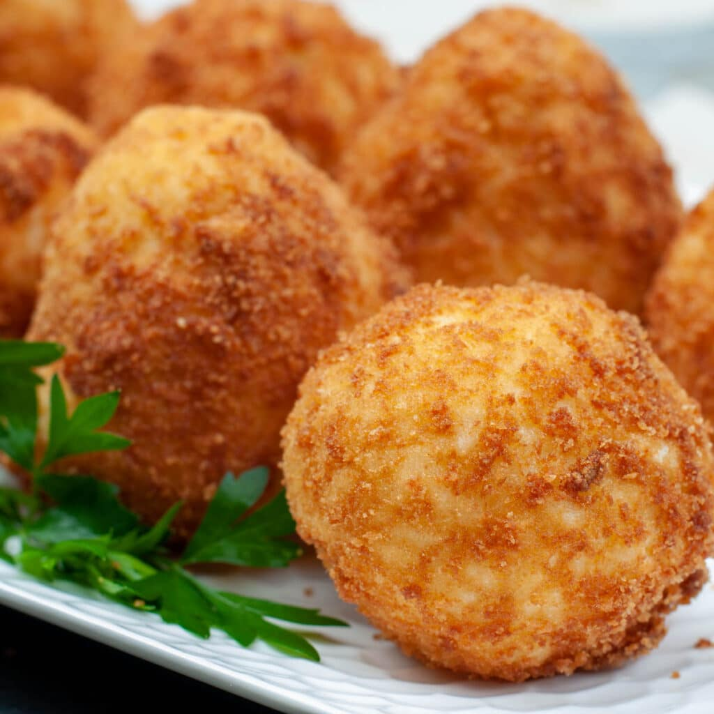 Arancini served on a tray