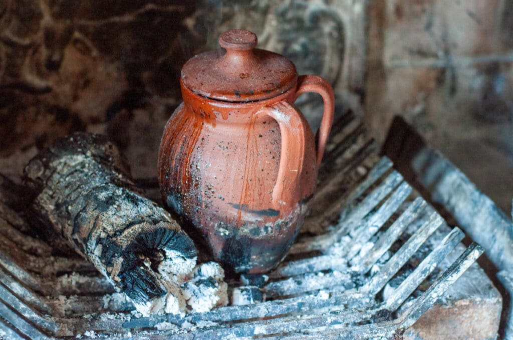 clay cooker in the fireplace