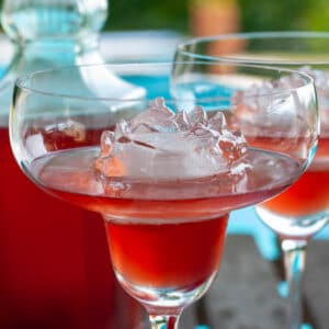 homemade strawberry liqueur in a glass served with ice