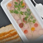 Ham spread terrine is elegant, delicate, and creamy. Decorated with herbs and flavored with cognac, it is very easy to make and you can make it days before your party. Turning leftover ham in a fancy dish.