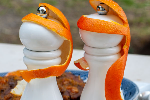 monkeys made of orange peel on salt and pepper graters
