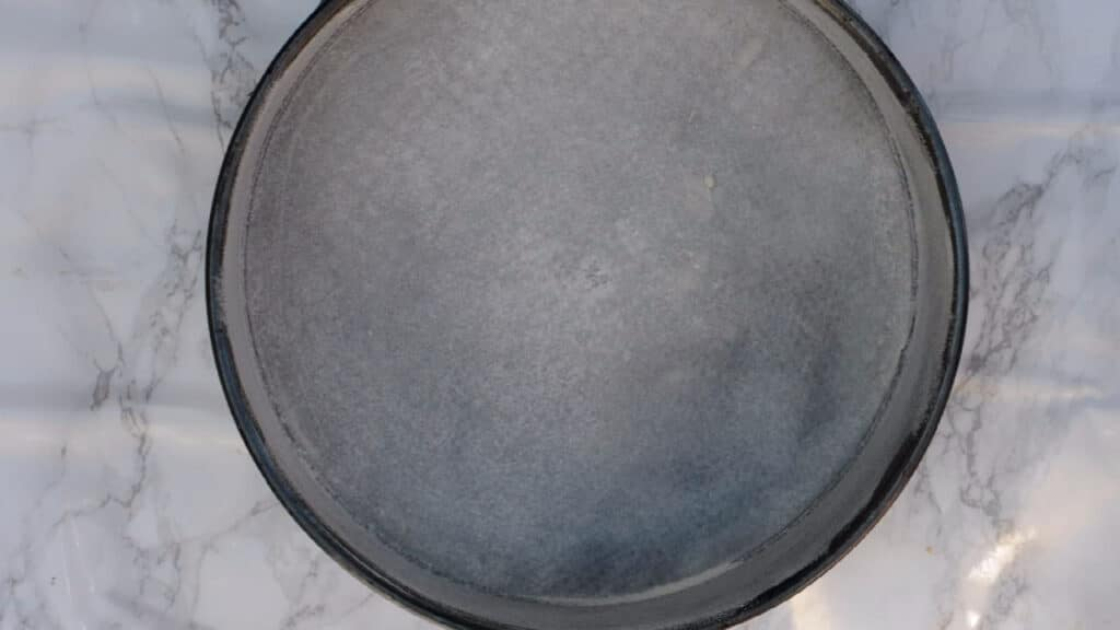 pan with removable bottom covered with parchment paper